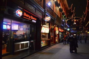 A couple takes a selfie on their iPhone in front of Dairy Queen at Yu Garden.
