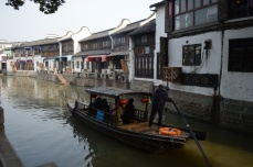 Boats are steered by local elderly men with a single oar.